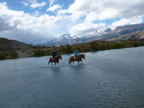Tango - Horse riding river